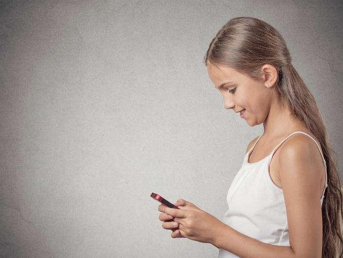 teenager girl working online on smart phone making earning money